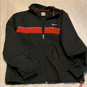 Nike windbreaker. Black with red stripe M